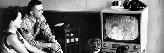 1950s-era family watches television